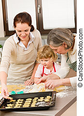 3 generations women prepare dough for baking - Happy little...