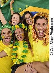 Group of Brazilian soccer fans - Happy group of Brazilian...