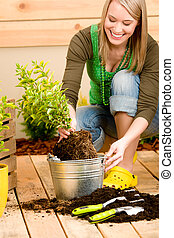Gardening woman planting on terrace in spring
