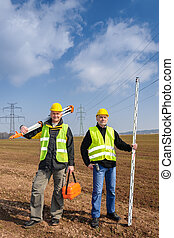 Geodesist two man equipment on construction site - Portrait...