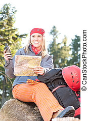 Active woman backpack search navigation map