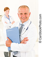 Medical doctor team senior male hold folders
