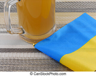 glass of beer with ukraine flag