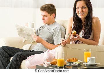 Young couple spending morning time together eating and...