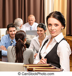 Waitress hold menu business people at restaurant - Young...