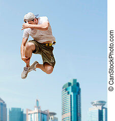 male dancer jumping in the air - dance and fitness concept -...
