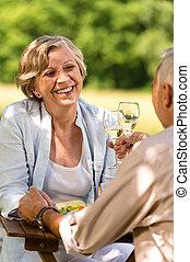 Senior couple celebrate outdoors happy retirement