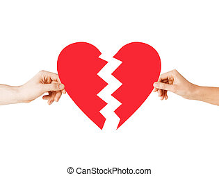 hands holding broken heart - love and relationship problems...