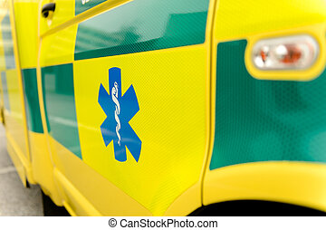 Paramedic symbol on yellow ambulance car