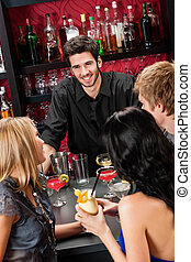 Barman chatting with friends drinking at bar - Cheerful...