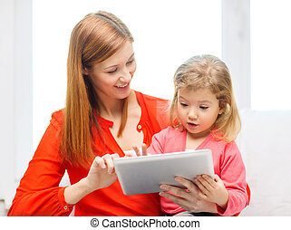 happy mother and daughter with tablet pc computer - family,...
