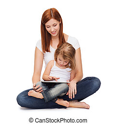 happy mother with little girl and tablet pc - childhood,...