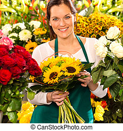 Smiling florist woman bouquet sunflowers flower shop...