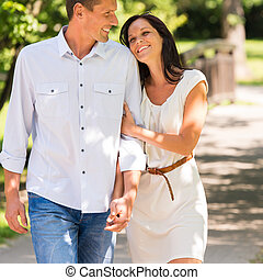 Young happy couple embracing in park - Portrait of young...