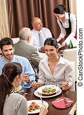 Business lunch restaurant people eating meal - Business...