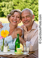 Cheerful senior couple smiling at camera