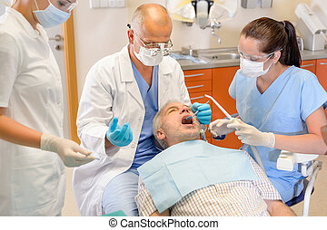 Senior man at dentist surgery have operation - Senior man at...