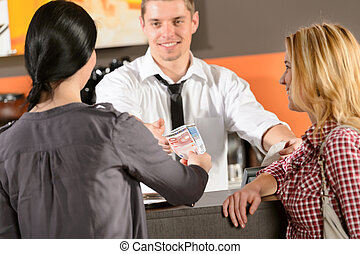 Female customers paying by cash EUR bar - Female customers...