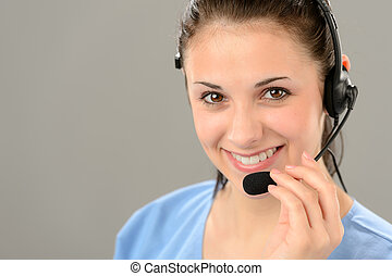 Friendly support phone operator wearing headset - Friendly...