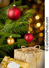 Christmas decoration tree, baubles and gifts on shining...