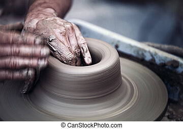 Hands working on pottery wheel , artistic toned - Hands...