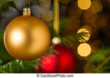 Gold christmas ball hanging on Xmas tree - Gold christmas...