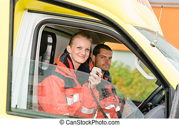 Emergency paramedic in ambulance car talk radio smiling...