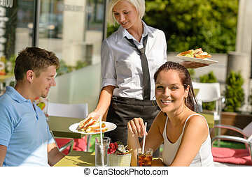 Waitress bring couple lunch food restaurant terrace -...