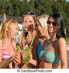 Young women in bikini partying with cocktails - Young women...