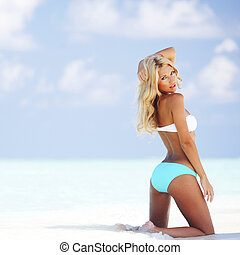 Woman in bikini on beach - Beautiful woman in bikini on...