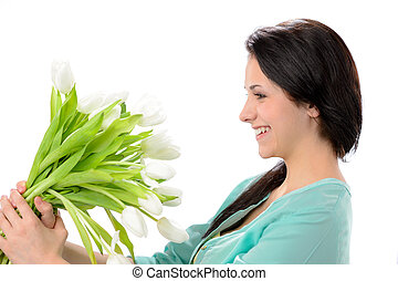 Elated young woman with bouquet of flowers