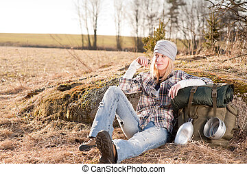 Camping young woman in countryside backpack relax - Camping...