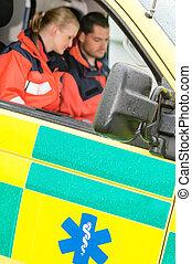 Emergency ambulance car paramedics sitting  work