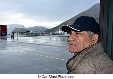 Mature man in international airport - Portrait of mature man...