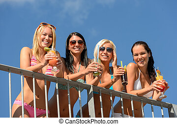 Beautiful women in bikinis smiling with drinks - Beautiful...