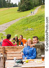 Young tourists in nature sitting bench - Young sporty...