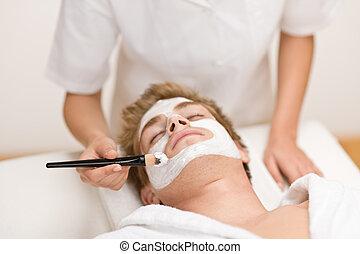 Male cosmetics - facial mask in salon