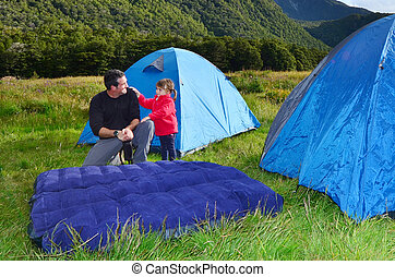 Family camping - Father and his daughter are camping in the...