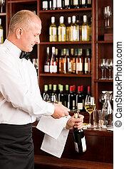 Wine bar waiter opening bottle restaurant - Wine bar...