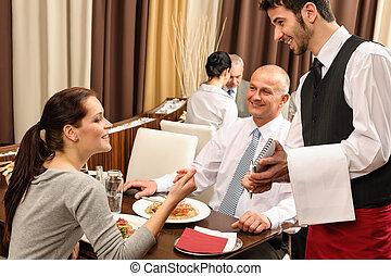 Business lunch waiter taking order at restaurant - Business...