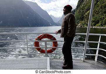 Man on a cruise boat - Mature man sail on a cruise boat in...