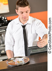 Young bartender in uniform taking cash euro - Young...