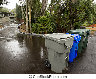 Trash, Recycling and Green Leaf Bins on the Street -...