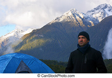 Man camping outdoors - Portrait of a tough man camping...