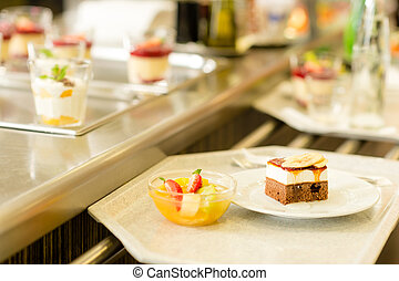 Desserts on serving tray cafeteria self service fruit salad...