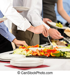 Business catering people take buffet food during company...