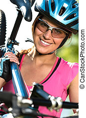 Female cyclist carrying her bike - Pretty female cyclist...
