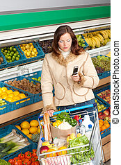 Grocery store shopping - Woman in winter outfit