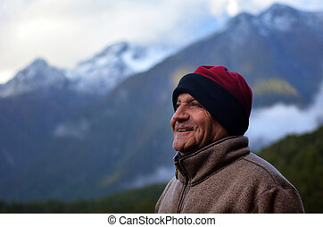 Man hiking - Happy mature man 70s smile after hiking in the...