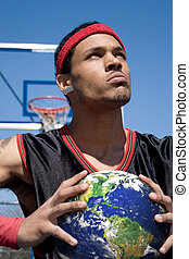 The World In Your Hands - A young basketball player gripping...